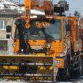 Autonomous rotary snow plows on the truck